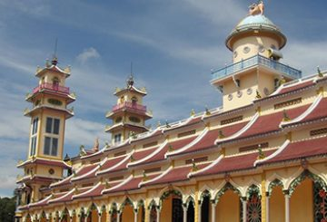 On the road to Tây Ninh, where a candy-coloured temple waits